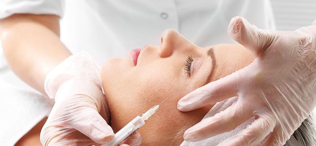 woman getting plastic surgery injection